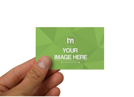 man holding business card with fingers mockup template sharetemplates