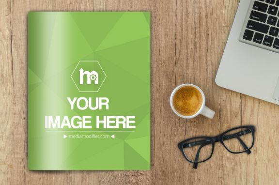 magazine on wood desk mockup generator